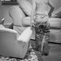 Trying on Boots, © Jacquelyn Cynkar. 